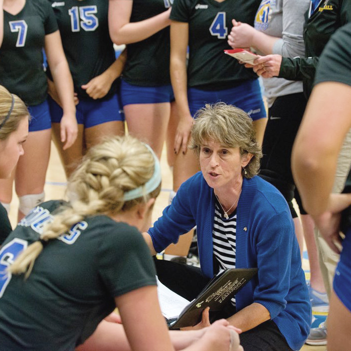 Volleyball Head Coach, Sue Sinclair, address her team during a time out.