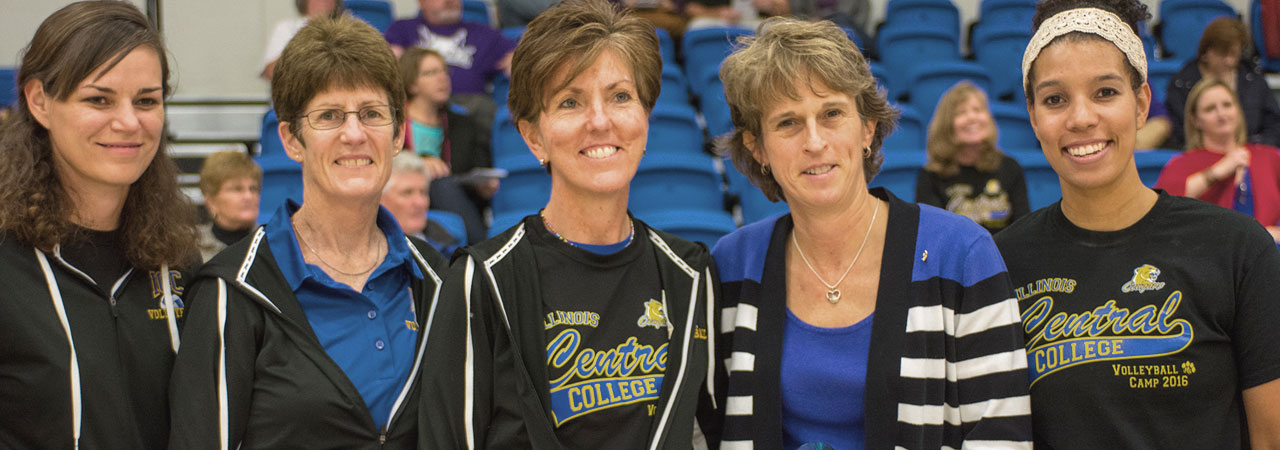Volleyball Head Coach, Sue Sinclair, poses with her coaching staff.
