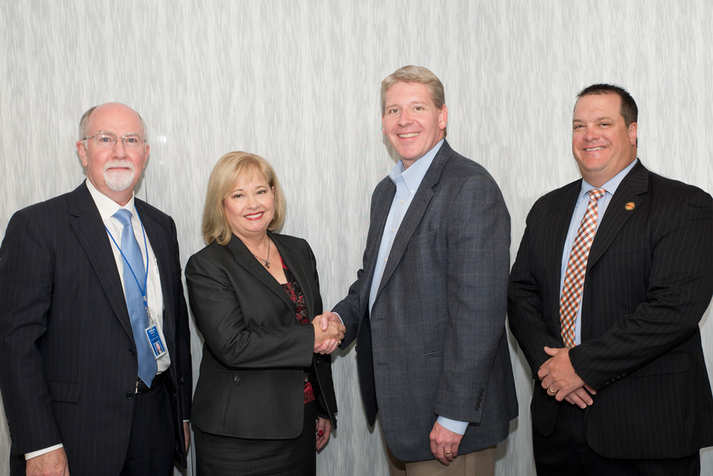 (From left to right) ICC Interim President Dr. William Tammone, ICC Board of Trustees Chair Susan Portscheller, WCHS Board of Education President Brad Butler, and WCHS District #308 Superintendent Dr. Kyle Freeman were on hand to celebrate the formal signing of the Strong Start agreement on July 28, 2015.