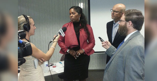 Rep. Jehan Gordon-Booth and Sen. David Koehler talk with reporters at a press conference about the MAP grant on Thursday, August 14 at ICC.